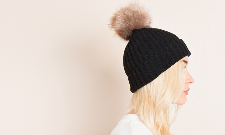 Fisherman style ribbed beanie hat with a detachable faux fur pom pom